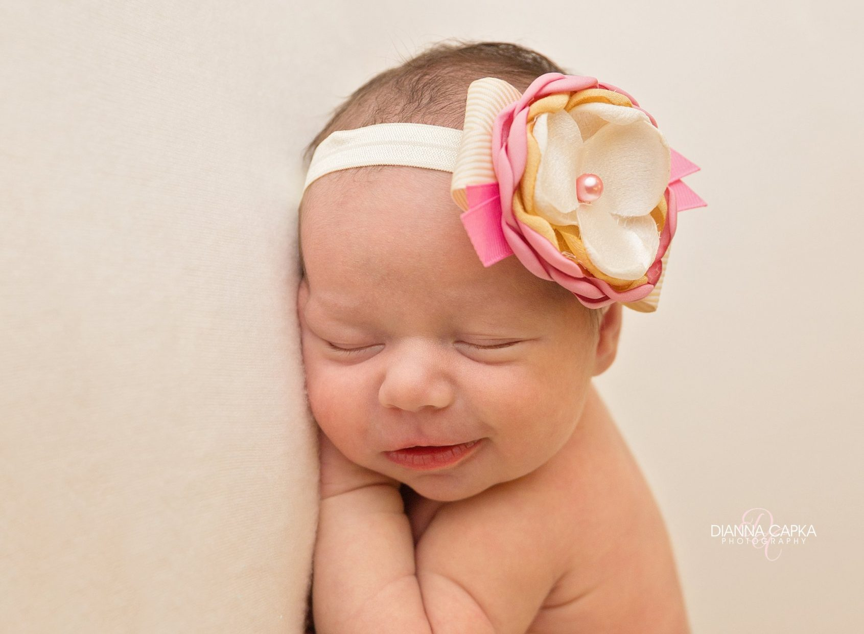 smiling newborn during her photosession